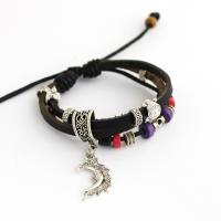 Leather bracelet with metallic and wooden charms