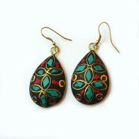 Beautiful drop earrings with pieces of gemstones, turquoise