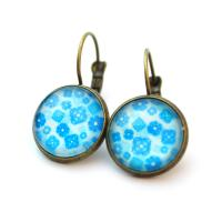 Cabochon earrings with blue flowers