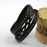 Leather bracelet with rivets and braided cord