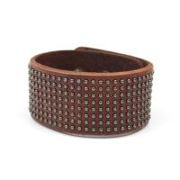 Leather bracelet with studs in brown