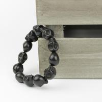 Skull bracelet of howlith stone beads in black