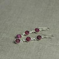 Ruby long earrings with three stones
