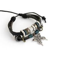 Leather bracelet with metallic charms and butterfly